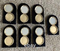 Lot of 7 Estee Lauder Empty Powder Compacts 6 Cherub Angles & 1 Spirit of Fire